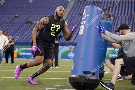 Virginia defensive lineman Drew Brown runs a drill at the NFL football scouting combine in Indianapolis