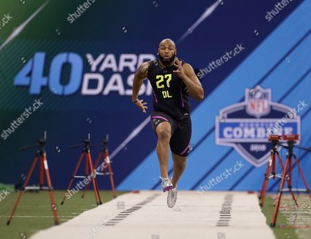 Virginia defensive lineman Drew Brown runs the 40-yard dash during the NFL football scouting combine, in Indianapolis