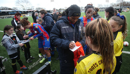 Mary Robinson of Crystal Palace Ladies signs autographs for members of Foots Cray Football Club after The Women's Premier League South match between Crystal Palace Ladies and Swindon Town Ladies, 4th March 2018 at Hayes Lane Stadium, Bromley.