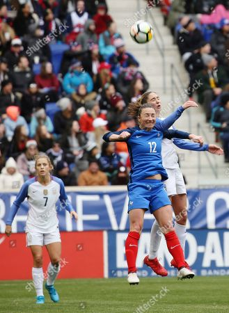 Gaetane Thiney, Morgan Brian. France midfielder Gaetane Thiney (12) and United States midfielder Morgan Brian (6) jump for the ball during the second half of a SheBelieves Cup women's soccer match, in Harrison, N.J. The match ended in a 1-1 draw
