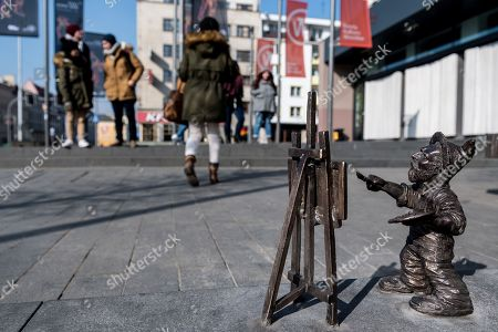 Stock Picture of A new dwarf in Wroclaw, Poland, 04 March 2018. The dwarf's name is Vincent and was created to commemorate the involvement of the city and Wroclaw institutions in the creation of the Oscar-nominated movie 'Loving Vincent', an animated biographical drama film about the life of Dutch artist Vincent van Gogh (1853-1890), by Dorota Kobieli and Hugh Welchman. The Vincent dwarf sculpture is by Polish artist Beata Zwolanska-Holod. Since 2005, small dwarf figurines have been placed in the streets of Wroclaw, in tribute of historic figures and events, among others.