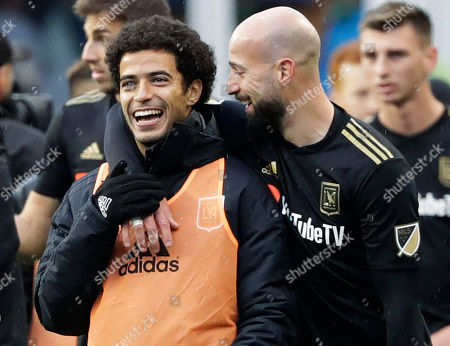 Los Angeles defender Laurent Ciman, right, celebrates with defender Omar Gaber after Los Angeles beat the Seattle Sounders 1-0 in an MLS soccer match, in Seattle