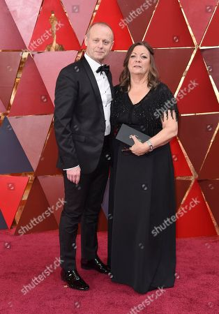 Daniel Phillips, Lou Sheppard. Daniel Phillips, left, and Lou Sheppard arrive at the Oscars, at the Dolby Theatre in Los Angeles