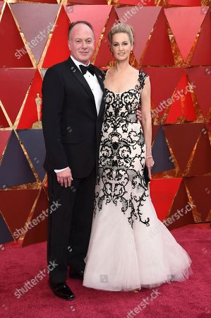 Stock Photo of Tom McGrath, Brieanne Cameron. Tom McGrath, left, and Brieanne Cameron arrive at the Oscars, at the Dolby Theatre in Los Angeles