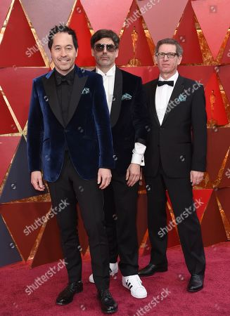 Stock Photo of Paul Denham Austerberry, Shane Vieau, and Jeffrey A. Melvin. Paul Denham Austerberry, from left, Shane Vieau, and Jeffrey A. Melvin arrive at the Oscars, at the Dolby Theatre in Los Angeles