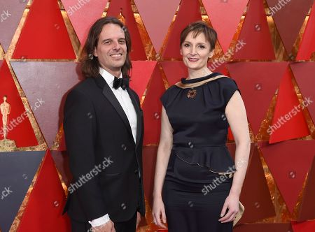Stock Image of Anthony Leo, Nora Twomey. Anthony Leo, left, and Nora Twomey arrive at the Oscars, at the Dolby Theatre in Los Angeles