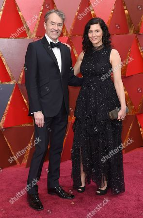 Carter Burwell, Christine Scuilli. Carter Burwell, left, and Christine Scuilli arrive at the Oscars, at the Dolby Theatre in Los Angeles