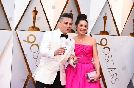 Stock Photo of Carlos Saldanha, Isabella Scarpa Saldanha. Carlos Saldanha, left, and Isabella Scarpa Saldanha arrive at the Oscars, at the Dolby Theatre in Los Angeles
