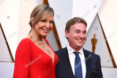 Stock Picture of Allison Janney, Steven Rogers. Allison Janney, left, and Steven Rogers arrive at the Oscars, at the Dolby Theatre in Los Angeles