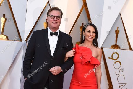 Aaron Sorkin, Molly Bloom. Aaron Sorkin, left, and Molly Bloom arrive at the Oscars, at the Dolby Theatre in Los Angeles