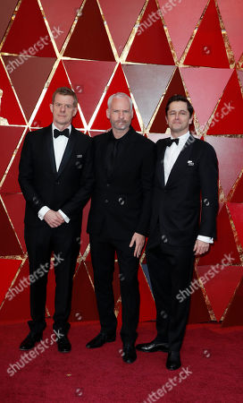 Stock Image of (L-R) Graham Broadbent , Martin McDonagh and Pete Czernin arrive for the 90th annual Academy Awards ceremony at the Dolby Theatre in Hollywood, California, USA, 04 March 2018. The Oscars are presented for outstanding individual or collective efforts in 24 categories in filmmaking.