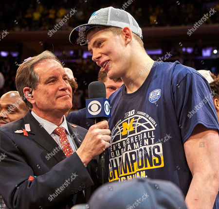 New York, New York, U.S. - Michigan Wolverines forward Moritz Wagner (13) interviews with CBS sportscaster Jim Nantz after being named MVP and defeating Purdue 75-66 to win the Big 10 Conference Men's Basketball Championship at Madison Square Garden in New York City