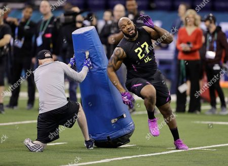 Virginia defensive lineman Drew Brown runs a drill during the NFL football scouting combine, in Indianapolis