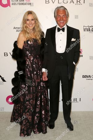 George Hamilton, Alana Stewart. George Hamilton, right, and Alana Stewart arrive at the 2018 Elton John AIDS Foundation Oscar Viewing Party, in West Hollywood, Calif