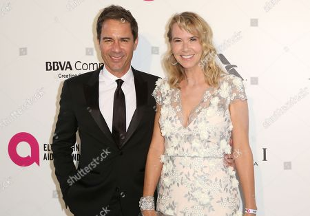 Eric McCormack, Janet Holden. Eric McCormack, left, and Janet Holden arrive at the 2018 Elton John AIDS Foundation Oscar Viewing Party, in West Hollywood, Calif