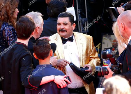 Wolfgang Puck, Guillermo Rodriguez. Wolfgang Puck, left, and Guillermo Rodriguez arrive at the Oscars, at the Dolby Theatre in Los Angeles