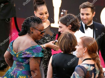 Whoopi Goldberg, Alex Martin, Timothee Chalamet. Whoopi Goldberg, from left, Alex Martin and Timothee Chalamet arrive at the Oscars, at the Dolby Theatre in Los Angeles