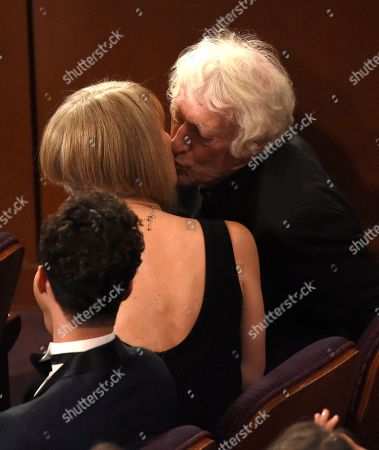 """Roger Deakins, right, winner of the award for best cinematography for """"Blade Runner 2049"""" kisses his wife, Isabella James Purefoy Ellis at the Oscars, at the Dolby Theatre in Los Angeles"""