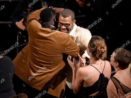 "Daniel Kaluuya, Jordan Peele. Daniel Kaluuya, left, congratulates Jordan Peele, winner of the award for best original screenplay for ""Get Out"" at the Oscars, at the Dolby Theatre in Los Angeles"