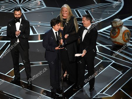 """Darla K. Anderson, Adrian Molina, Anthony Gonzalez, Lee Unkrich. Adrian Molina, from left, Anthony Gonzalez, Darla K. Anderson and Lee Unkrich accept the award for best animated feature film for """"Coco"""" at the Oscars, at the Dolby Theatre in Los Angeles"""