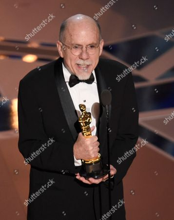 """Richard King accepts the award for best sound editing for """"Dunkirk"""" at the Oscars, at the Dolby Theatre in Los Angeles"""