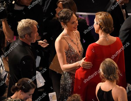 Stock Image of Gal Gadot, Yaron Varsano, Allison Janney. Yaron Varsano, from left, Gal Gadot and Allison Janney appear in the audience at the Oscars, at the Dolby Theatre in Los Angeles