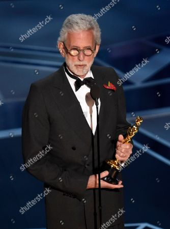 """Frank Stiefel accepts the award for best documentary short subject for """"Heaven is a Traffic Jam on the 405"""" at the Oscars, at the Dolby Theatre in Los Angeles"""