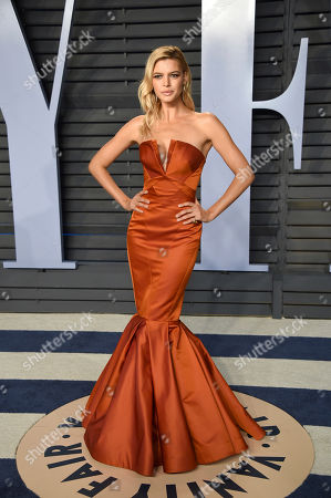 Kelly Rohrbach arrives at the Vanity Fair Oscar Party, in Beverly Hills, Calif
