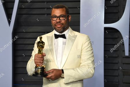 """Jordan Peele, winner of the award for best original screenplay for """"Get Out,"""" arrives at the Vanity Fair Oscar Party, in Beverly Hills, Calif"""