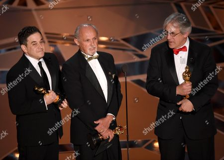 """Gary A. Rizzo, Gregg Landaker, Mark Weingarten. Gary A. Rizzo, from left, Gregg Landaker, and Mark Weingarten accept the award for best sound mixing for """"Dunkirk"""" at the Oscars, at the Dolby Theatre in Los Angeles"""