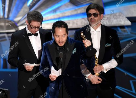 """Stock Picture of Jeffrey A. Melvin, Paul Denham Austerberry, Shane Vieau. Jeffrey A. Melvin, from left, Paul Denham Austerberry, and Shane Vieau accept the award for best production design for """"The Shape of Water"""" at the Oscars, at the Dolby Theatre in Los Angeles"""