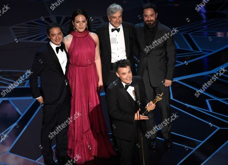 "Sebastian Lelio, Nicolas Saavedra, Daniela Vega, Alejandro Goic, Pablo Larrain. Sebastian Lelio, foreground center, and Nicolas Saavedra, from back left, Daniela Vega, Alejandro Goic, and Pablo Larrain accept the award for best foreign language film for ""A Fantastic Woman"" at the Oscars, at the Dolby Theatre in Los Angeles"