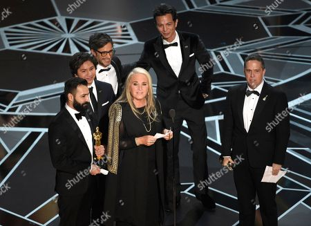 "Darla K. Anderson, Adrian Molina, Anthony Gonzalez, Gael Garcia Bernal, Benjamin Bratt, Lee Unkrich. Darla K. Anderson, center, and from back left, Adrian Molina, Anthony Gonzalez, Gael Garcia Bernal, Benjamin Bratt, and Lee Unkrich accept the award for best animated feature film for ""Coco"" at the Oscars, at the Dolby Theatre in Los Angeles"
