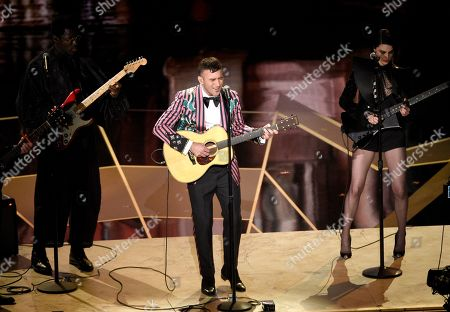"Stock Photo of Sufjan Stevens, St. Vincent, Moses Sumney. Moses Sumney, from left, Sufjan Stevens, and St. Vincent perform ""Mystery of Love"" from the film ""Call Me By Your Name"" at the Oscars, at the Dolby Theatre in Los Angeles"