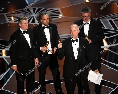 "Richard R. Hoover, Paul Lambert, John Nelson, Gerd Nefzer. Richard R. Hoover, from left, Paul Lambert, John Nelson, and Gerd Nefzer accept the award for best visual effects for ""Blade Runner 2049"" at the Oscars, at the Dolby Theatre in Los Angeles"