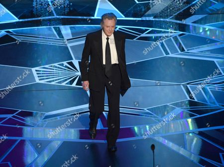 Christopher Walken presents the award for best original score at the Oscars, at the Dolby Theatre in Los Angeles