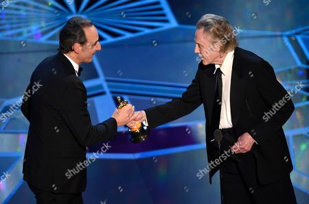 """Alexandre Desplat, Christopher Walken. Christopher Walken, right, presents Alexandre Desplat with the award for best original score for """"The Shape of Water"""" at the Oscars, at the Dolby Theatre in Los Angeles"""