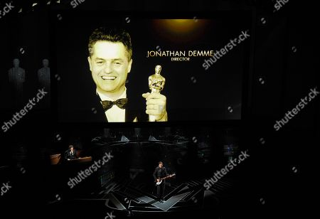 Jonathan Demme appears on screen as Eddie Vedder performs during an In Memoriam tribute at the Oscars, at the Dolby Theatre in Los Angeles