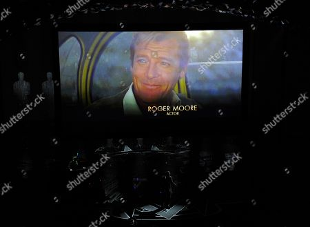 Roger Moore appears on screen as Eddie Vedder performs during an In Memoriam tribute at the Oscars, at the Dolby Theatre in Los Angeles