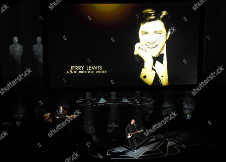 Jerry Lewis appears on screen as Eddie Vedder performs during an In Memoriam tribute at the Oscars, at the Dolby Theatre in Los Angeles