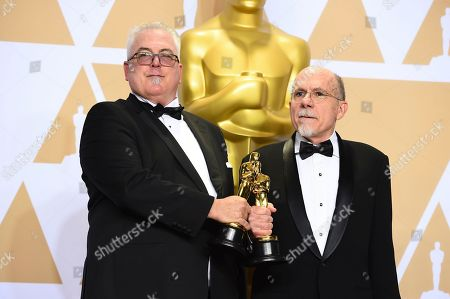 """Alex Gibson, Richard King. Alex Gibson, left, and Richard King, winners of the award for best sound editing for """"Dunkirk"""", pose in the press room at the Oscars, at the Dolby Theatre in Los Angeles"""