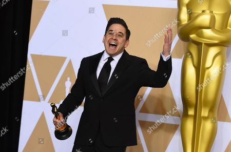 """Gary A. Rizzo, winner of the award for best sound mixing for """"Dunkirk"""", poses in the press room at the Oscars, at the Dolby Theatre in Los Angeles"""