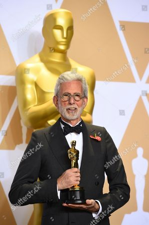 """Frank Stiefel, winner of the award for best documentary short subject for """"Heaven is a Traffic Jam on the 405"""", poses in the press room at the Oscars, at the Dolby Theatre in Los Angeles"""
