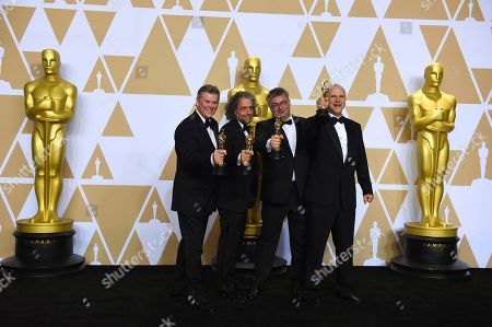 "Richard R. Hoover, Paul Lambert, Gerd Nefzer, John Nelson. Richard R. Hoover, from left, Paul Lambert, Gerd Nefzer, and John Nelson, winners o the award for best visual effects for ""Blade Runner 2049"", pose in the press room at the Oscars, at the Dolby Theatre in Los Angeles"