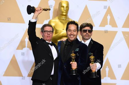 """Jeffrey A Melvin, Paul D. Austerberry, Shane Vieau. Jeffrey A Melvin, from left, Paul D. Austerberry, and Shane Vieau, winners of the award for best production design for """"The Shape of Water"""", pose in the press room at the Oscars, at the Dolby Theatre in Los Angeles"""
