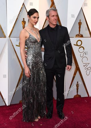 Gal Gadot, Yaron Varsano. Gal Gadot, left, and Yaron Varsano arrive at the Oscars, at the Dolby Theatre in Los Angeles