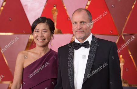 Laura Louie, Woody Harrelson. Laura Louie, left, and Woody Harrelson arrive at the Oscars, at the Dolby Theatre in Los Angeles