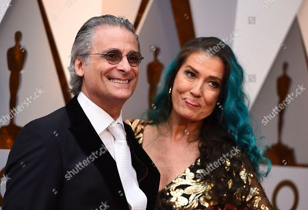 Stock Image of Mark Mangini, Ann Mangin. Mark Mangini, and Ann Mangini arrive at the Oscars, at the Dolby Theatre in Los Angeles