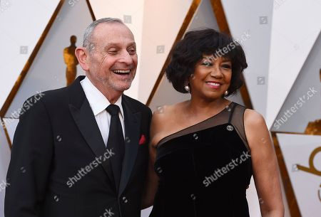 Stanley Isaacs, Cheryl Boone Isaacs. Stanley Isaacs, left, and Cheryl Boone Isaacs arrive at the Oscars, at the Dolby Theatre in Los Angeles
