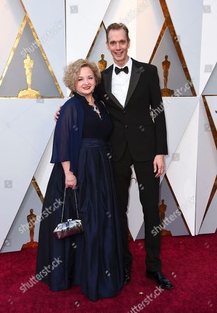Stock Image of Laurie Jones, Doug Jones. Laurie Jones, left, and Doug Jones arrive at the Oscars, at the Dolby Theatre in Los Angeles